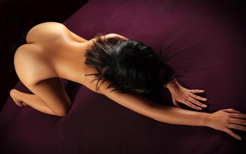 Sexy woman on spa salon massage with bearded handsome therapist